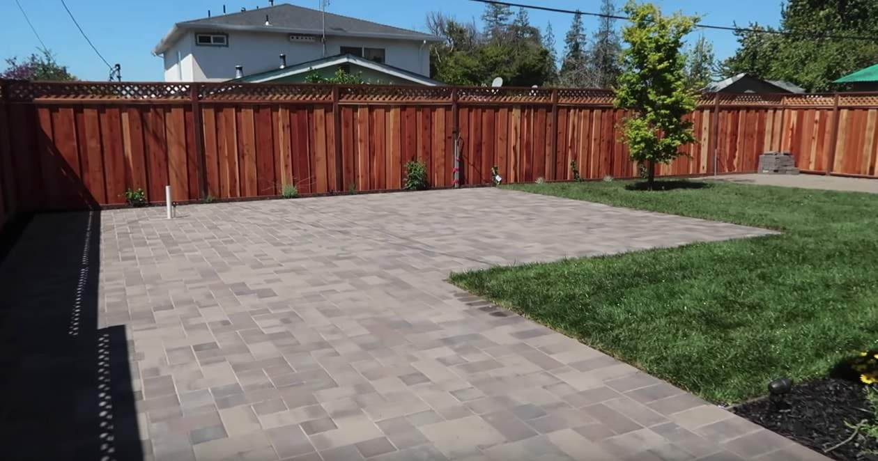landscape company completing the installation of paver stones